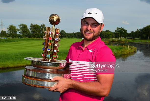 Jordan Smith of England poses with the trophy after winning the Porsche European Open during the Porsche European Open Day Four at Green Eagle Golf...
