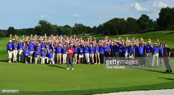Jordan Smith of England poses with the trophy and the volunteers after winning the Porsche European Open during the Porsche European Open Day Four at...