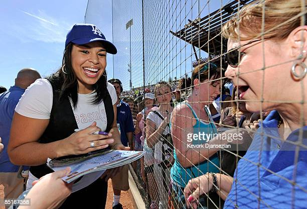 Jordan Sparks signs autographs after singing the national anthem during pregame ceremonies for the Los Angeles Dodgers home opener against the...