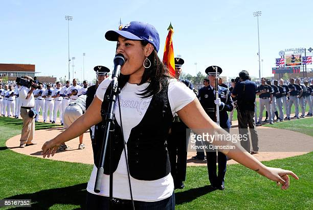 Jordan Sparks sings the national anthem during pregame ceremonies for the Los Angeles Dodgers home opener against the Chicago Whites Sox at Camelback...