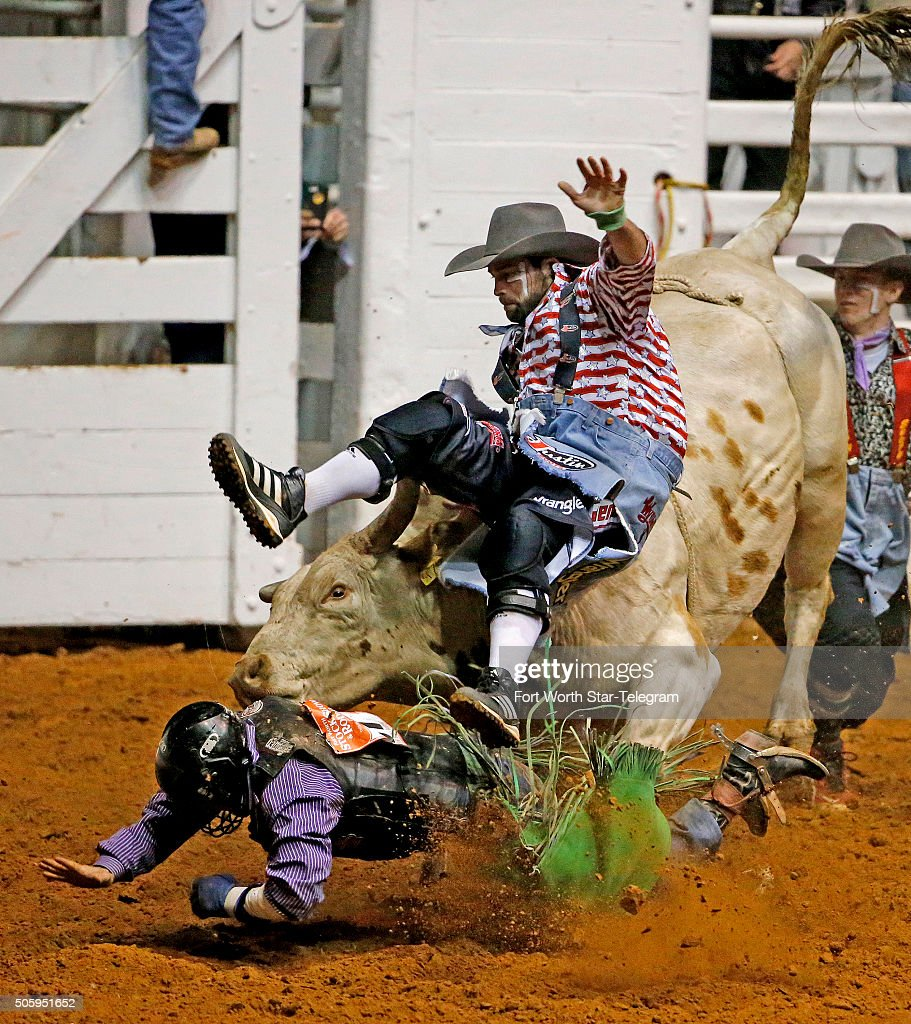 Jordan Spears manages to hang on to 'Haunted Mesa' for 8.0 seconds, but the bull turns on him and one of the bullfighting clowns comes to the rescue, but got hit by the bull as well during the second night of competition in the Bulls' Night Out at the Fort Worth Stock Show Rodeo in Fort Worth, Texas, on Wednesday, Jan. 20, 2016.