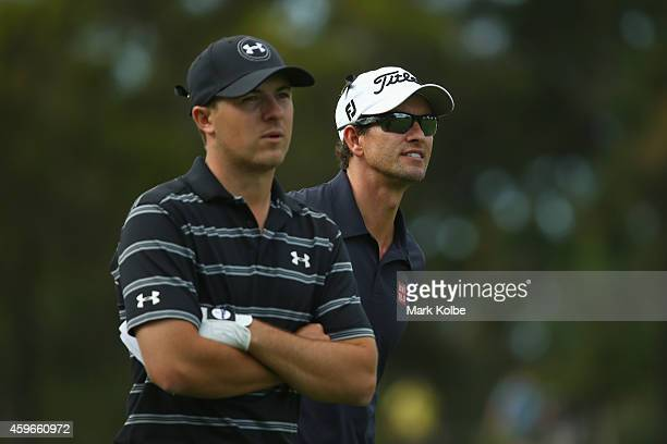 Jordan Speith of the USA and Aadm Scott of Australia watch on during day two of the Australian Open at The Australian Golf Course on November 28 2014...