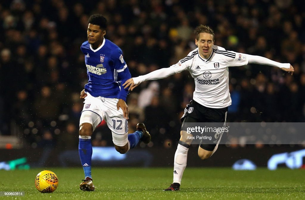 Jordan Spence of Ipswich is pulled back by Stefan Johansen of Fulham during the Sky Bet Championship match between Fulham and Ipswich Town at Craven Cottage on January 2, 2018 in London, England.