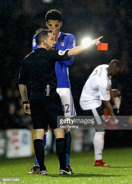 Jordan Spence of Ipswich is shown a red card during the Sky Bet Championship match between Fulham and Ipswich Town at Craven Cottage on January 2...