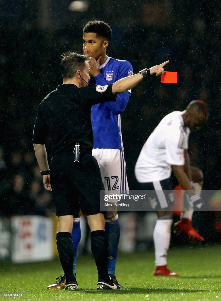 Jordan Spence of Ipswich is shown a red card during the Sky Bet Championship match between Fulham and Ipswich Town at Craven Cottage on January 2, 2018 in London, England.