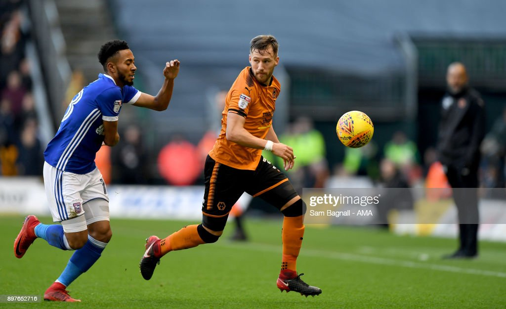 Jordan Spence of Ipswich Town and Barry Douglas of Wolverhampton Wanderers during the Sky Bet Championship match between Wolverhampton and Ipswich Town at Molineux on December 23, 2017 in Wolverhampton, England.