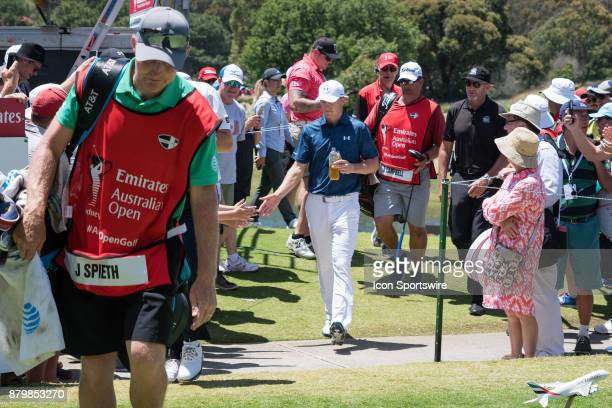 Jordan Spieth acknowledges the crowd at the final round of the 102nd Australian Open Golf Championship at The Australian Golf Club in Sydney on...