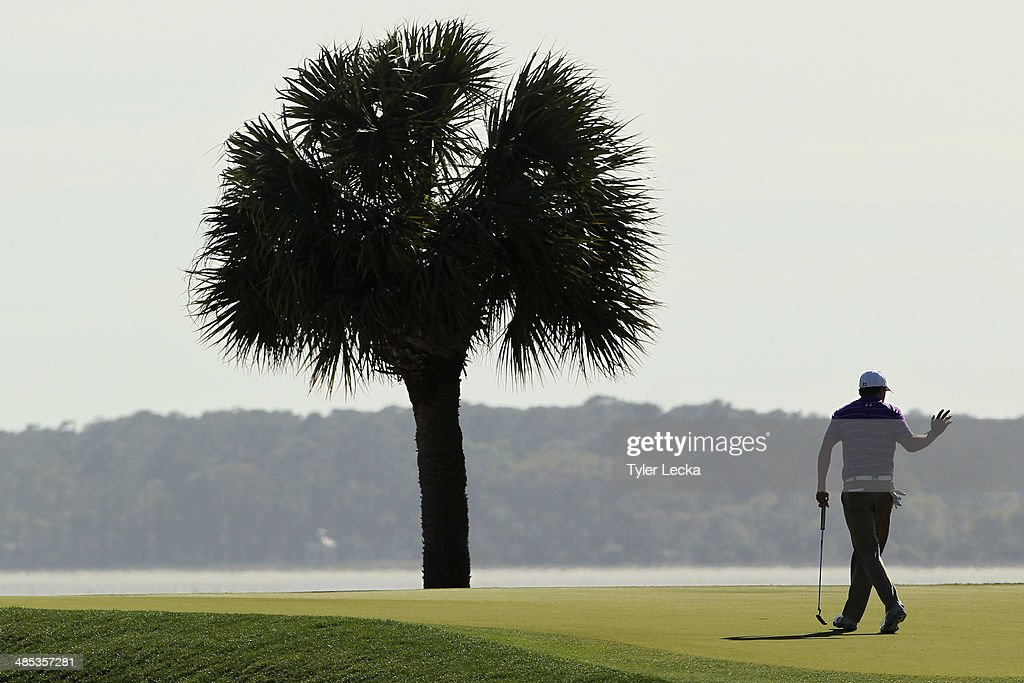 Jordan Spieth acknowledges the gallery on the 17th green during the first round of the RBC Heritage at Harbour Town Golf Links on April 17, 2014 in Hilton Head Island, South Carolina.