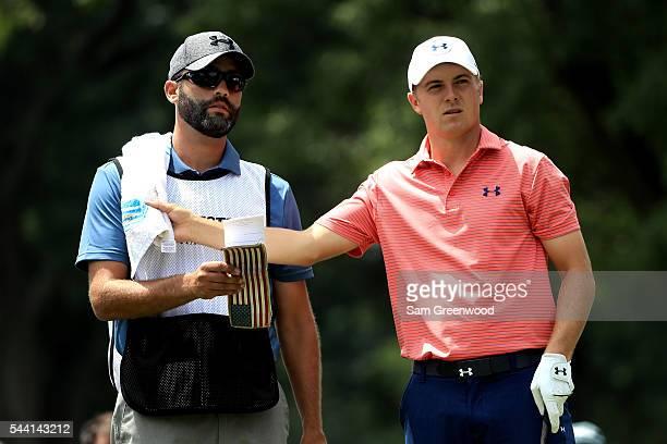Jordan Spieth and caddie Michael Greller prepare to hit off the third tee during the second round of the World Golf Championships Bridgestone...