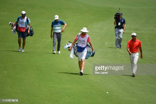 Jordan Spieth and CT Pan of Taiwan walk with their caddies on the fifth hole during the final round of the Charles Schwab Challenge at Colonial...