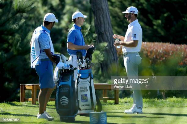 Jordan Spieth and Dustin Johnson meet at the 17th tee during Round Two of the ATT Pebble Beach ProAm at Monterey Peninsula Country Club on February 9...
