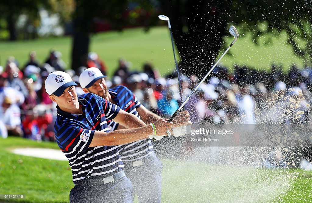 Jordan Spieth and Dustin Johnson of the United States hit out of a bunker during practice prior to the 2016 Ryder Cup at Hazeltine National Golf Club on September 29, 2016 in Chaska, Minnesota.