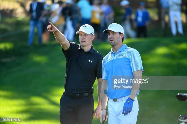 Jordan Spieth and Jake Owen discuss strategy on a tee during the first round of the ATT Pebble Beach ProAm at Pebble Beach Golf Links on February 8...