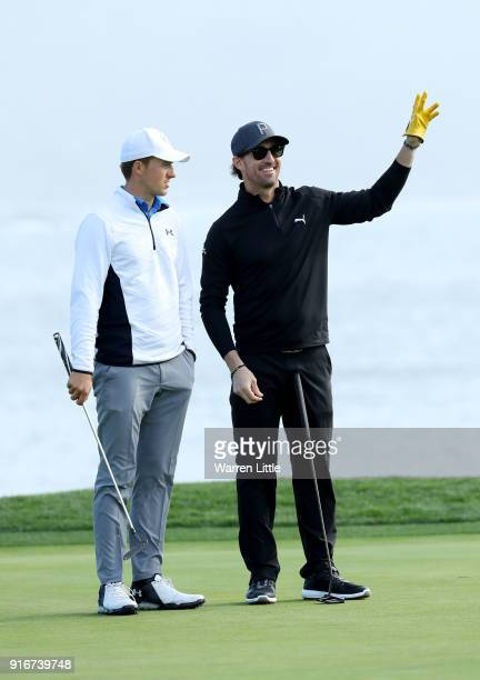 Jordan Spieth and Jake Owen stand on the 18th green during Round Three of the ATT Pebble Beach ProAm at Spyglass Hill Golf Course on February 10 2018...