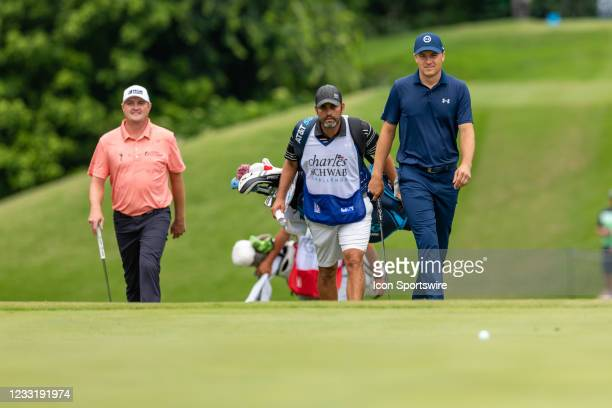 Jordan Spieth and Jason Kokrak walk up to the 8th green during the final round of the Charles Schwab Challenge on May 30, 2021 at Colonial Country...