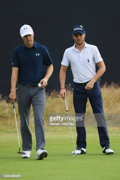 Jordan Spieth and Justin Thomas of the United States at the 14th hole green while practicing during previews to the 147th Open Championship at...