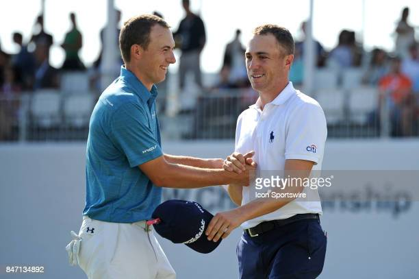 Jordan Spieth and Justin Thomas shake hands after completing 18th hole during the First Round of the BMW Championship on September 14 at Conway Farms...