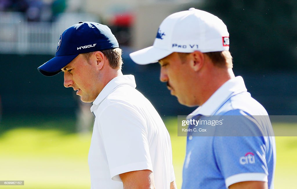 Jordan Spieth (L) and Justin Thomas walks on the 15th hole during the second round of the TOUR Championship at East Lake Golf Club on September 23, 2016 in Atlanta, Georgia.