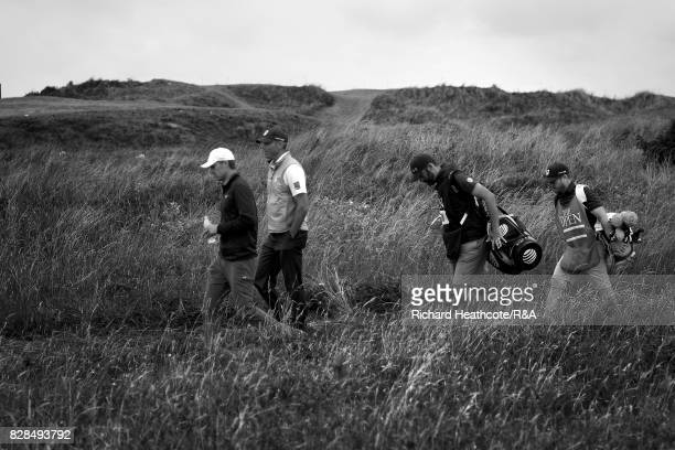 Jordan Spieth and Matt Kuchar of the USA walk down the 11th hole during the final round of the 146th Open Championship at Royal Birkdale on July 23...
