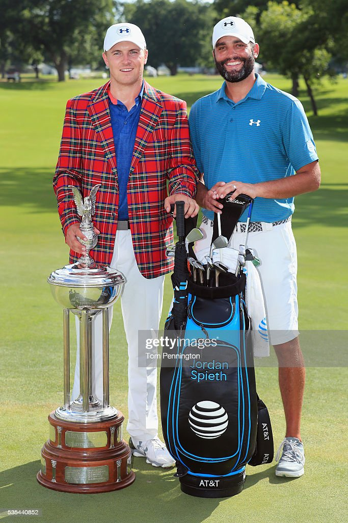 Jordan Spieth and Micahel Greller pose with the trophy after winning the DEAN & DELUCA Invitational at Colonial Country Club on May 29, 2016 in Fort Worth, Texas.