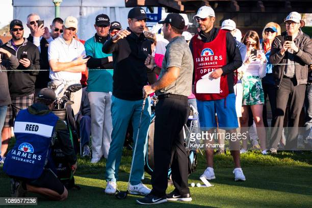 Jordan Spieth and Patrick Reed hug on the first tee during the third round of the Farmers Insurance Open on Torrey Pines South on January 26 2019 in...