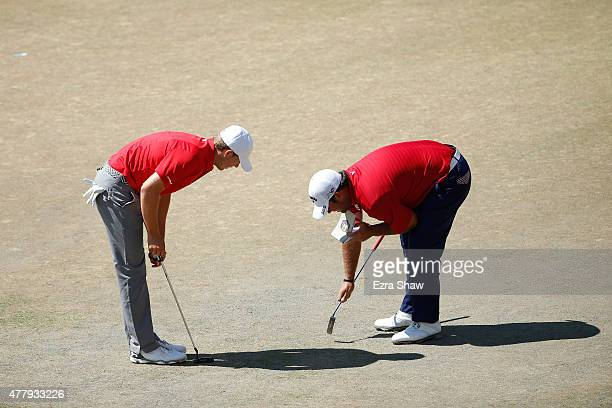 Jordan Spieth and Patrick Reed of the United States look over the fourth green during the third round of the 115th US Open Championship at Chambers...