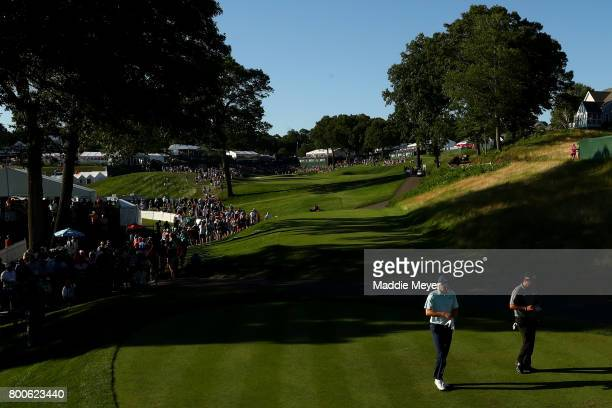 Jordan Spieth and Patrick Reed of the United States walk to the 18th tee during the third round of the Travelers Championship at TPC River Highlands...