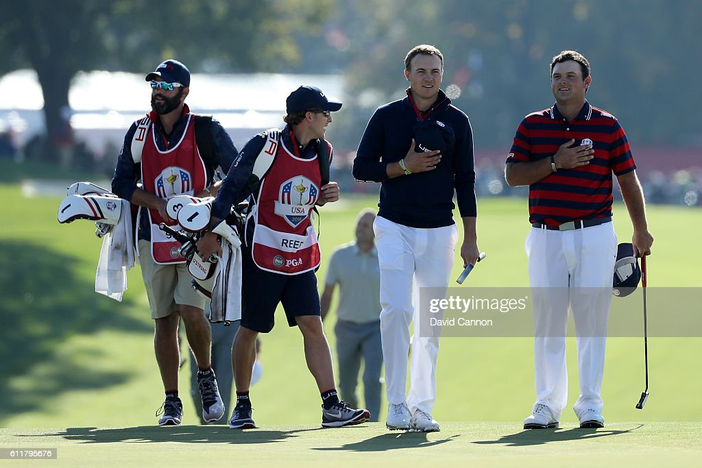 Jordan Spieth and Patrick Reed of the United States walk to the ninth green with their hands on their hearts as the crowd sings the national anthem during morning foursome matches of the 2016 Ryder Cup at Hazeltine National Golf Club on October 1, 2016 in Chaska, Minnesota.