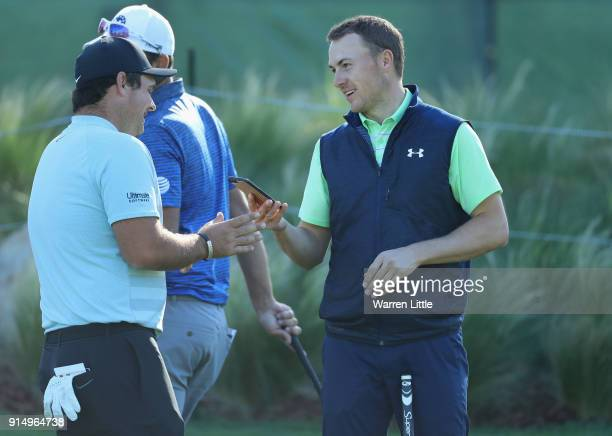 Jordan Spieth and Patrick Reed of the USA share a joke ahead of the ATT Pebble Beach ProAm on February 6 2018 in Pebble Beach California