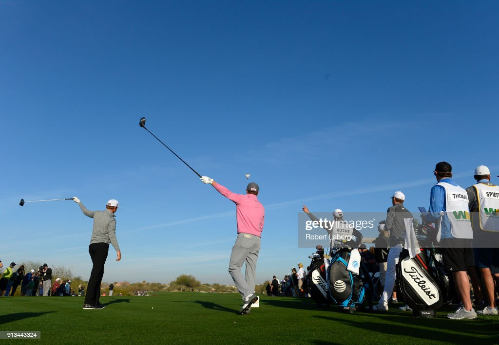 Jordan Spieth and Patton Kizzire react to a tee shot on the 13th hole during the second round of the Waste Management Phoenix Open at TPC Scottsdale on February 2, 2018 in Scottsdale, Arizona.