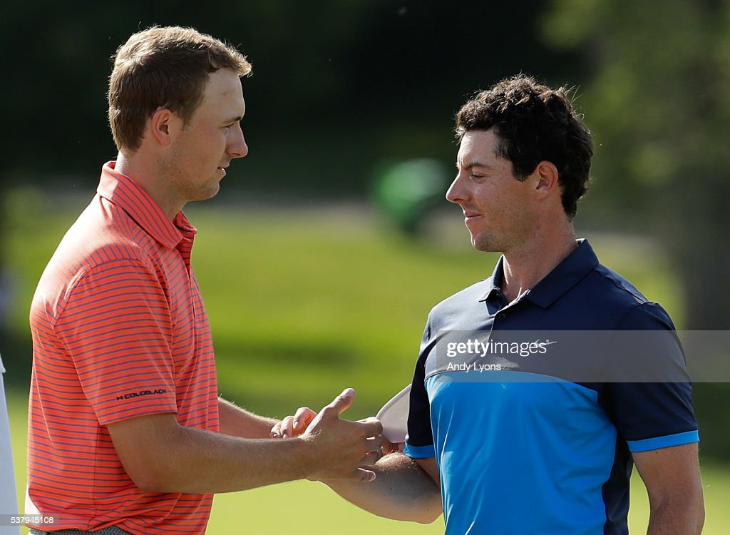 Jordan Spieth and Rory McIlroy of Norther Ireland shake hands after their round on the 18th hole during the second round of The Memorial Tournament at Muirfield Village Golf Club on June 3, 2016 in Dublin, Ohio.