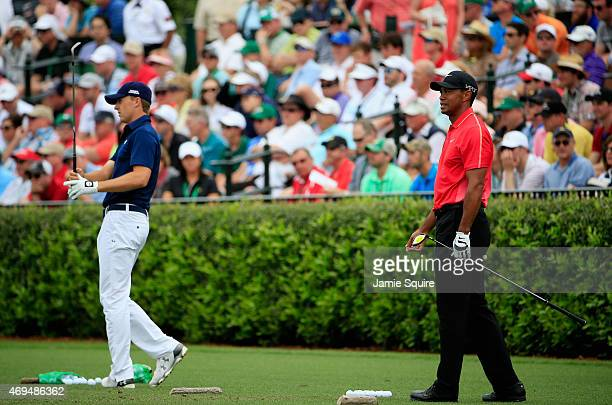 Jordan Spieth and Tiger Woods of the United States work on the practice ground during the final round of the 2015 Masters Tournament at Augusta...