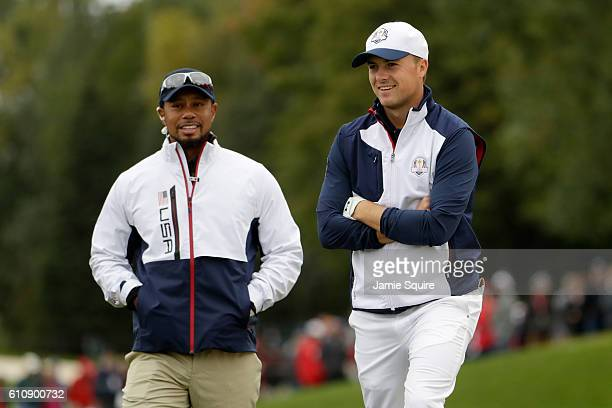 Jordan Spieth and vicecaptain Tiger Woods of the United States look on during practice prior to the 2016 Ryder Cup at Hazeltine National Golf Club on...