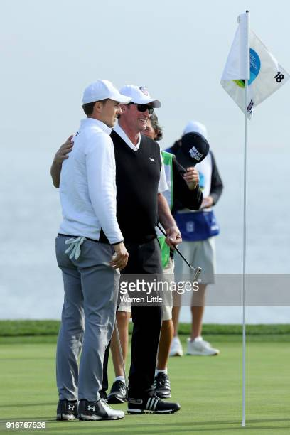 Jordan Spieth and Wayne Gretzky meet after finishing their round on the 18th green during Round Three of the ATT Pebble Beach ProAm at Pebble Beach...