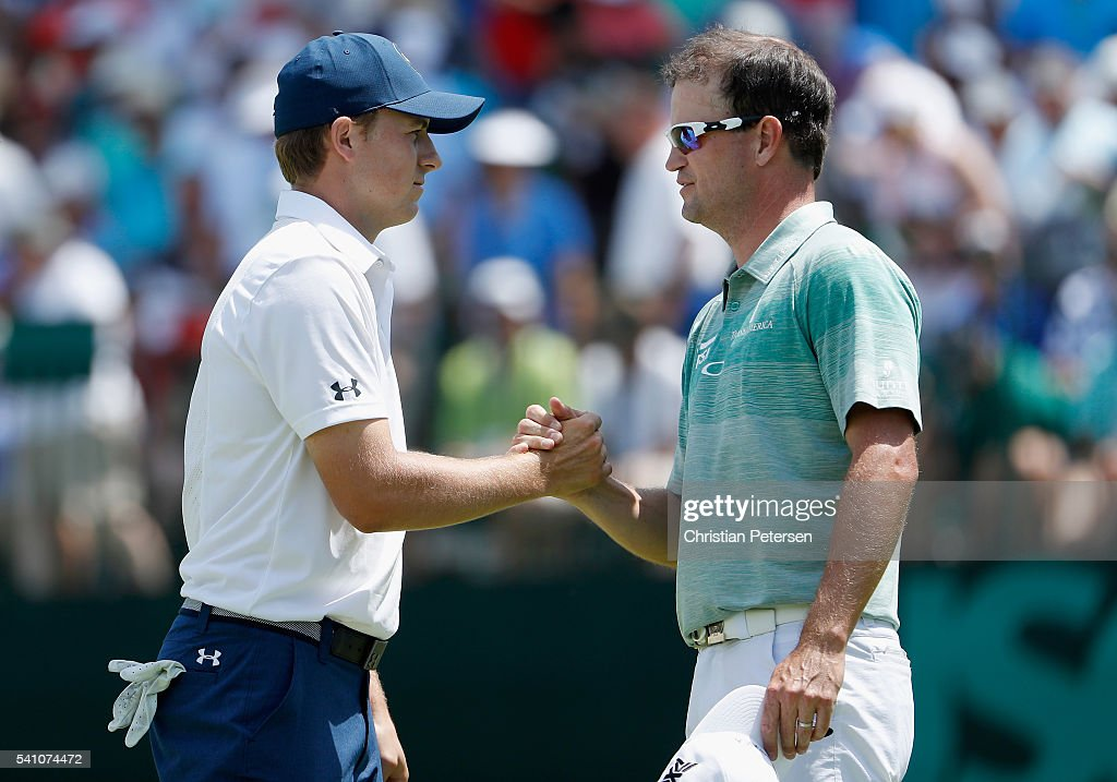 Jordan Spieth and Zach Johnson of the United States shake hands following the completion of the continuation second round of the U.S. Open at Oakmont Country Club on June 18, 2016 in Oakmont, Pennsylvania.