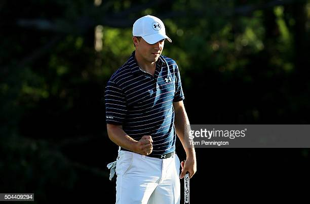Jordan Spieth celebrates on the 18th green after putting for birdie to go 30 under and win the final round of the Hyundai Tournament of Champions at...