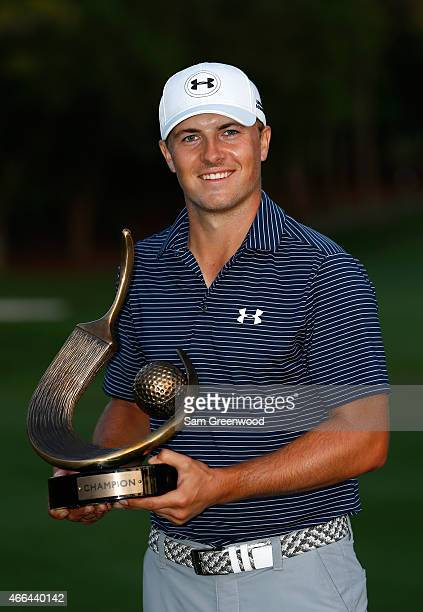 Jordan Spieth celebrates with his trophy after winning the Valspar Championship on the third playoff hole during the final round at Innisbrook Resort...