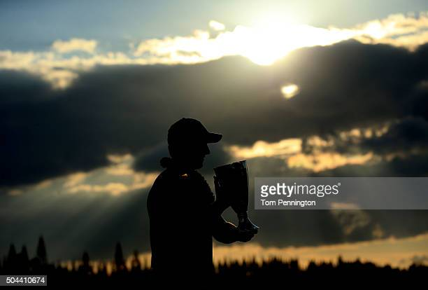 Jordan Spieth celebrates with the trophy after winning the final round of the Hyundai Tournament of Champions at the Plantation Course at Kapalua...