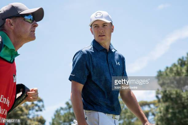 Jordan Spieth chats with his caddy at the final round of the 102nd Australian Open Golf Championship at The Australian Golf Club in Sydney on...