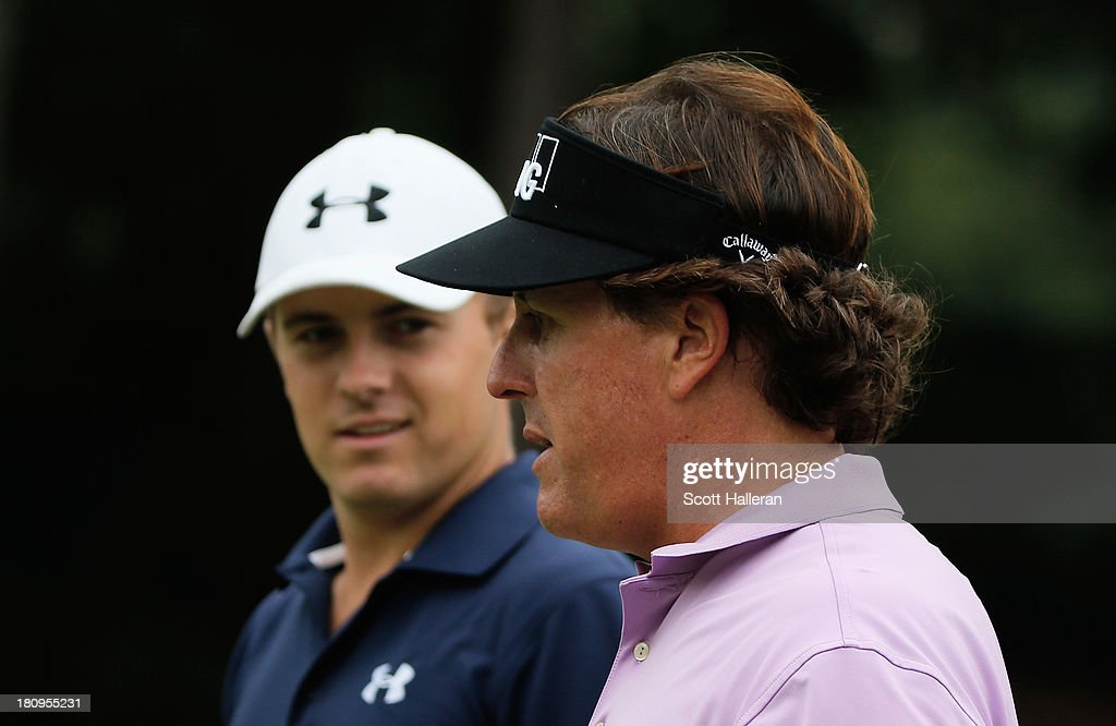 Jordan Spieth (L) chats with Phil Mickelson during a practice round prior to the start of the TOUR Championship by Coca-Cola at East Lake Golf Club on September 18, 2013 in Atlanta, Georgia.