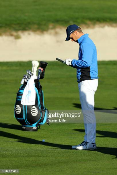 Jordan Spieth checks his scorecard on the fourth hole during the Final Round of the ATT Pebble Beach ProAm at Pebble Beach Golf Links on February 11...