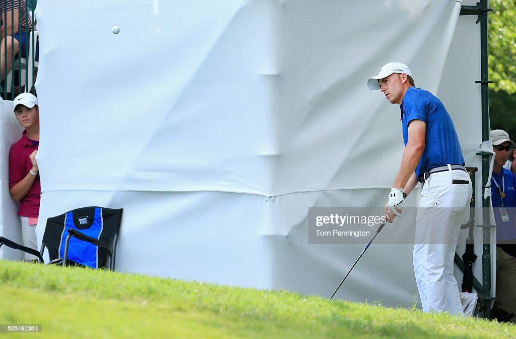 Jordan Spieth chips in for birdie on the 17th hole during the Final Round of the DEAN & DELUCA Invitational at Colonial Country Club on May 29, 2016 in Fort Worth, Texas.