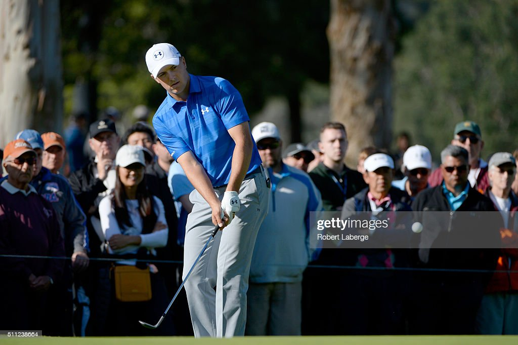 Jordan Spieth chips on the 12th hole during round one of the Northern Trust Open at Riviera Country Club on February 18, 2016 in Pacific Palisades, California.