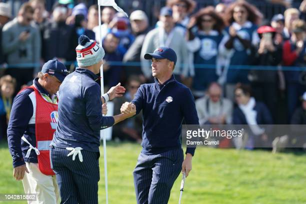 Jordan Spieth congratulates Justin Thomas on the 17th hole during the Saturday Morning Fourballs at the 42nd Ryder Cup held at Le Golf National on...
