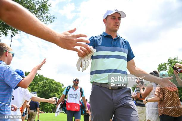 Jordan Spieth fist bumps fans while walking to the eighth tee box during the final round of the Charles Schwab Challenge at Colonial Country Club on...