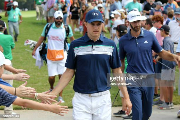 Jordan Spieth greets fans during the final round of the PGA Tour Championship on September 24 2017 at East Lake Golf Club in Atlanta Georgia
