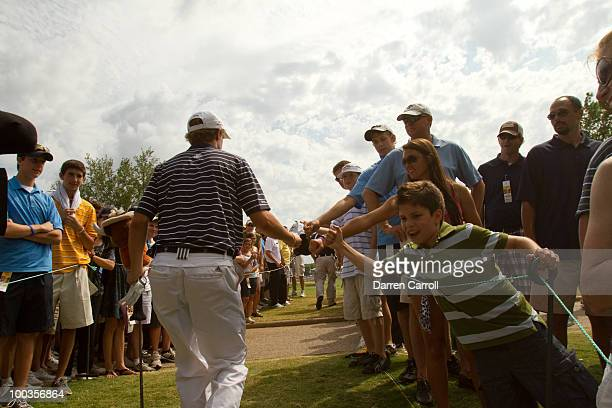 Jordan Spieth high-fives spectators during the fourth round of the HP Byron Nelson Championship at TPC Four Seasons Resort Las Colinas on May 23,...