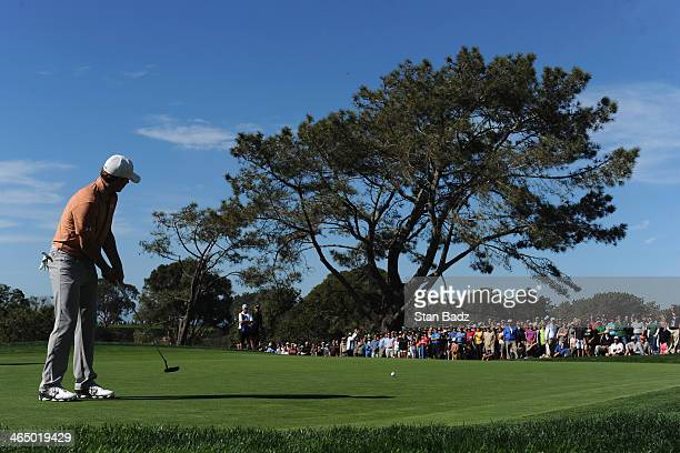 Jordan Spieth hits a putt on the 8th green during the third round of the Farmers Insurance Open on Torrey Pines South on January 25, 2014 in La...