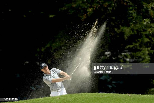 Jordan Spieth hits a shot from the sand on the first hole during the third round of the Wyndham Championship at Sedgefield Country Club on August 03,...
