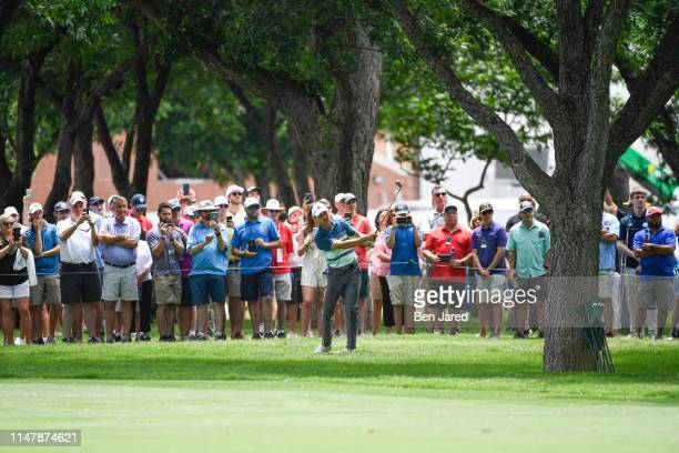 Jordan Spieth hits a shot on the seventh hole during the final round of the Charles Schwab Challenge at Colonial Country Club on May 26 2019 in Fort...